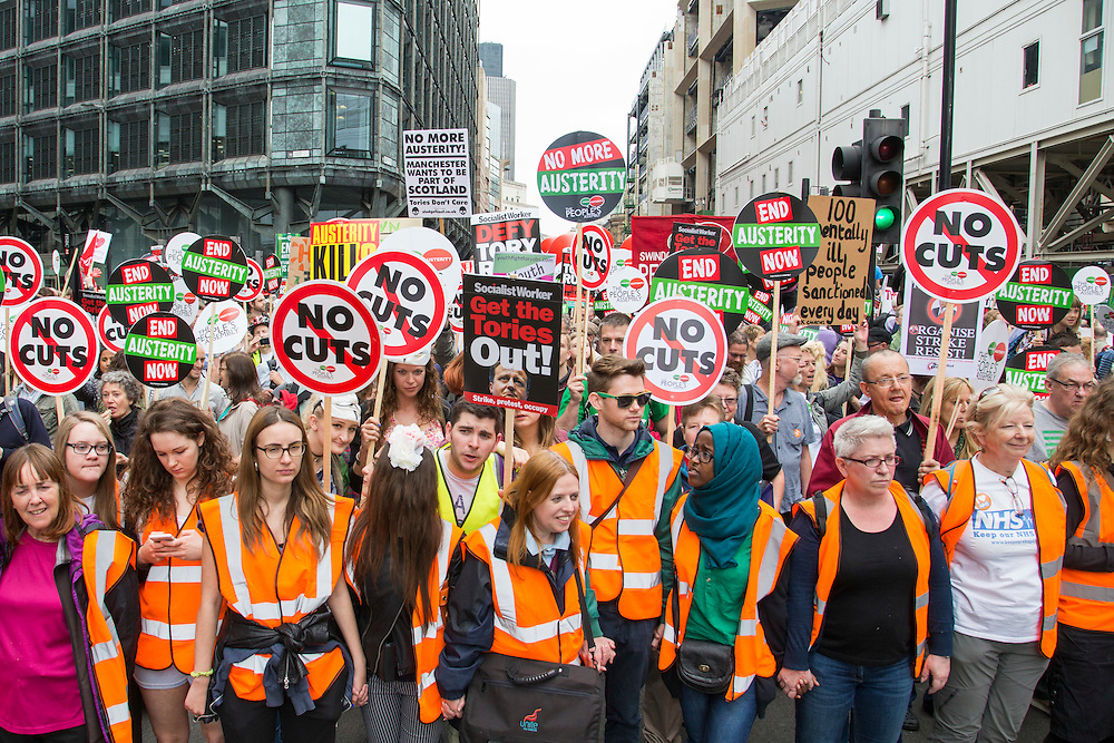 Volunteers holding the front line at the People's Assembly Against Austerity 'End Austerity Now' demonstration attended by over 250,000 people on Saturday 20th of June 2015 sending a clear message to the Tory government; demanding an alternative to austerity and to policies that only benefit those at the top. London, UK.