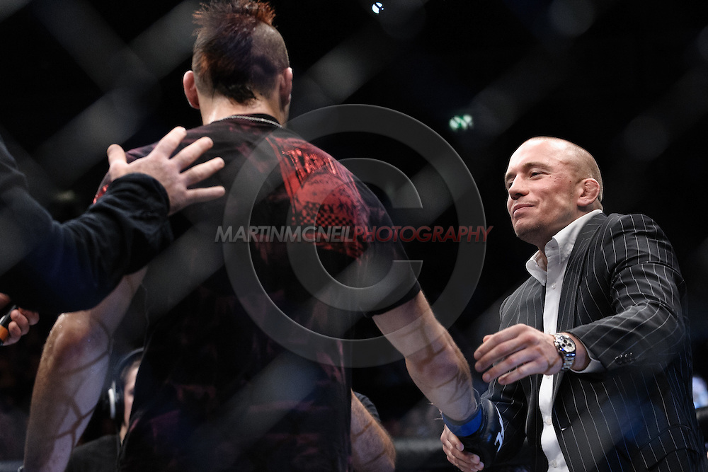"""MANCHESTER, ENGLAND, NOVEMBER 14, 2009: Georges St. Pierre (facing) congratulates Dan Hardy on his win during """"UFC 105: Couture vs. Vera"""" inside the MEN Arena in Manchester, United Kingdom."""