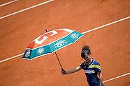 Girl with umbrella on main court of Philippe Chartier while Day Second during The French Open 2013 at Roland Garros Tennis Club in Paris, France...France, Paris, May 27, 2013..Picture also available in RAW (NEF) or TIFF format on special request...For editorial use only. Any commercial or promotional use requires permission...Mandatory credit:.Photo by © Adam Nurkiewicz / Mediasport