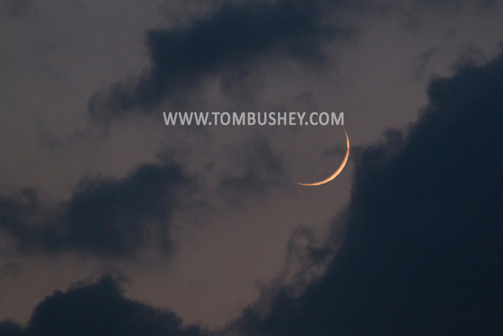 Town of Wallkill, New York - A view of the crescent moon and clouds at twilight on May 19, 2015.