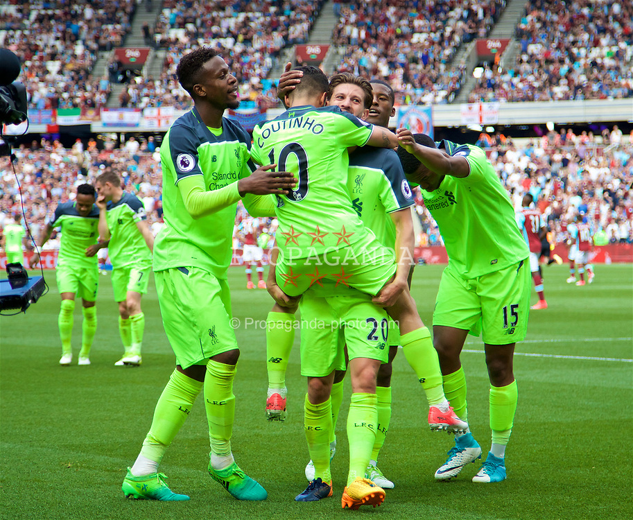 LONDON, ENGLAND - Sunday, May 14, 2017: Liverpool's Philippe Coutinho Correia celebrates scoring the third goal against West Ham United with team-mates Adam Lallana and Divock Origi during the FA Premier League match at the London Stadium. (Pic by David Rawcliffe/Propaganda)