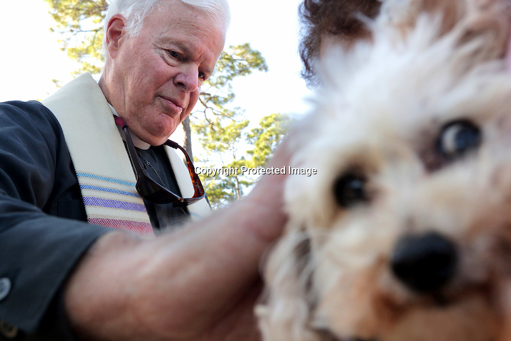 Father Dan Macgill blesses Pumpkin during the St. Frances Day Blessing of the Animals Sunday October 5, 2014 at Hugh McRae Park in Wilmington, N.C. The event was sponsored by Good Shepherd Church. (Jason A. Frizzelle)