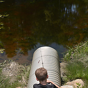 PHIPPSBURG, Maine --  6/1/14 --   Tyler Pettengill , 9, of Cumberland fishes in a creek near his great grandmother's house in Phippsburg. Fish weren't biting - yet - but it was great day to fish. Photo © Roger S. Duncan 2014.