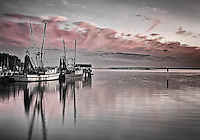 Shem Creek shrimp boats black and white with pink sky