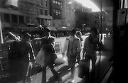 """Street scene seen through shop window in Chinatown...Part of long-term (2005-2008) story """"I See A Darkness"""". New York, NY."""