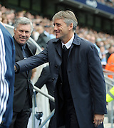 Roberto Mancini shakes hands with the Chelsea staff before the Barclays Premier League match between Manchester City and Chelsea at the City of Manchester Stadium on September 25, 2010 in Manchester, England.