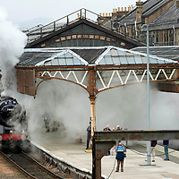 Perth railway station fills with smoke as the Great Britain III en-route from Inverness to Edinburgh pulled by BR Britannia Class &MT 4-6-2 no 70013 Oliver Cromwell and LNER K4 Class 2-6-0 no 61994 The Great Marquess leaves the station.....13.04.10<br /> Picture by Graeme Hart.<br /> Copyright Perthshire Picture Agency<br /> Tel: 01738 623350  Mobile: 07990 594431