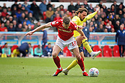 Nottingham Forest defender Jack Robinson (18)  is fouled by Blackburn Rovers midfielder Bradley Dack (23) during the EFL Sky Bet Championship match between Nottingham Forest and Blackburn Rovers at the City Ground, Nottingham, England on 13 April 2019.