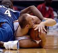 MORNING JOURNAL/DAVID RICHARD.Cleveland's Zydrunas Ilgauskas, right, calls for timeout while battling Antawn Jamison of Washington last night in the second quarter. Game officials ruled a jump ball.