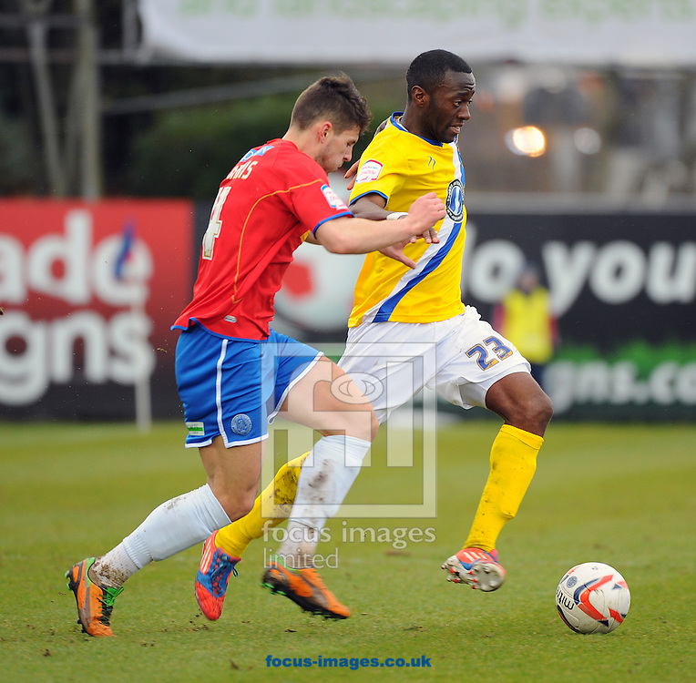 Picture by Seb Daly/Focus Images Ltd +447738 614630.16/03/2013.Aaron Morris of Aldershot Town and Rashid Youssouf of AFC Wimbledon during the npower League 2 match at the EBB Stadium, Aldershot.