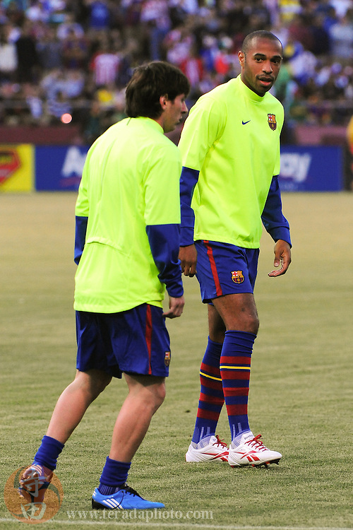 August 8, 2009; San Francisco, CA, USA; FC Barcelona forward Thierry Henry (right) speaks to forward Lionel Messi (left) during warms up before the match against Chivas de Guadalajara in the Night of Champions international friendly contest at Candlestick Park. The game ended in a 1-1 tie.