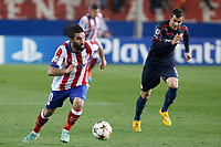 Atletico de Madrid´s Arda Turan (L) and Olympiacos´s Milivojevic during Champions League soccer match between Atletico de Madrid and Olympiacos at Vicente Calderon stadium in Madrid, Spain. November 26, 2014. (ALTERPHOTOS/Victor Blanco)