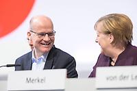 22 NOV 2019, LEIPZIG/GERMANY:<br /> Ralph Brinkhaus (L), CDU, Vorsitzender der CDU/CSU Bundestagsfraktion, und Angela Merkel (R), CDU, Bundeskanzlerin, CDU Bundesparteitag, CCL Leipzig<br /> IMAGE: 20191122-01-043<br /> KEYWORDS: Parteitag, party congress, lacht, lachen, freundlich