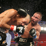 Sergei Lipinets (R) punches Cosme Rivera with an overhand right during a Telemundo Boxeo boxing match at the A La Carte Pavilion on Friday,  March 13, 2015 in Tampa, Florida.  Lipinets won the bout. (AP Photo/Alex Menendez)