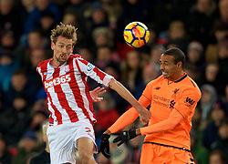 STOKE-ON-TRENT, ENGLAND - Wednesday, November 29, 2017: Liverpool's Joel Matip and Stoke City's Peter Crouch during the FA Premier League match between Stoke City and Liverpool at the  Bet365 Stadium. (Pic by David Rawcliffe/Propaganda)