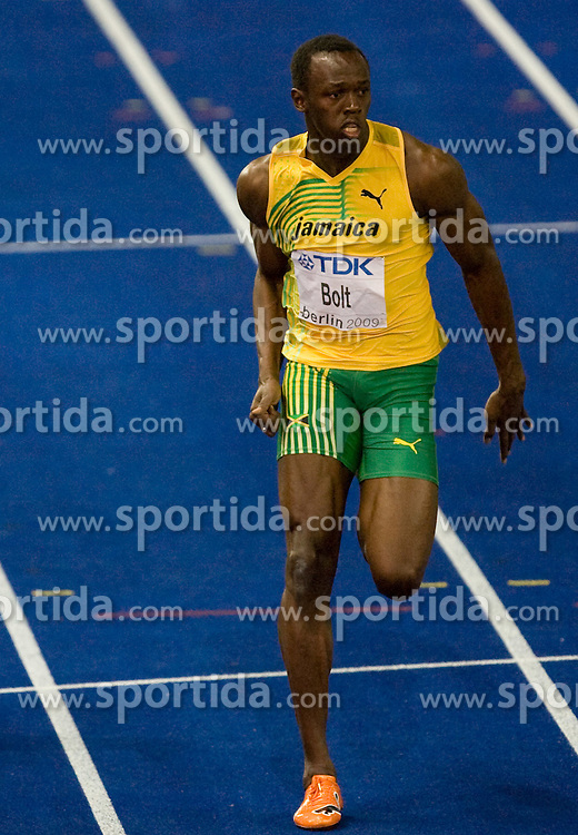 Jamaica's Usain Bolt competes in the men's 100m final race of the 2009 IAAF Athletics World Championships ahead of US Tyson Gay and Jamaica's Asafa Powell on August 16, 2009 in Berlin. Jamaican Usain Bolt set a new world record of 9.58 seconds in winning the final of the men's 100m at the World Athletics Championships. His time bettered his own world record of 9.69sec set in the Beijing Olympics final. (Photo by Vid Ponikvar / Sportida)