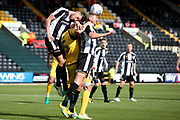 Notts County forward Jonathan Stead (30) wins the header in his own penalty area during the EFL Sky Bet League 2 match between Notts County and Morecambe at Meadow Lane, Nottingham, England on 9 September 2017. Photo by Simon Davies.