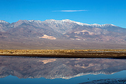 Panamint mountain range reflected in a pond, Death Valley National Park, California, United States of America