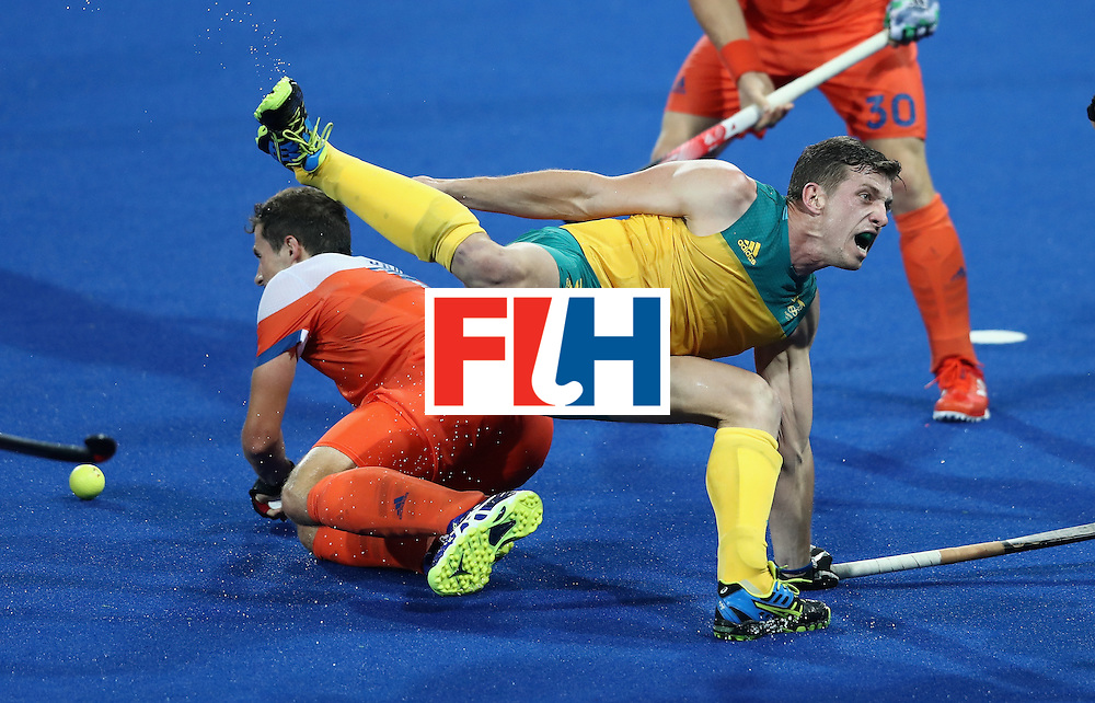 RIO DE JANEIRO, BRAZIL - AUGUST 14:  Simon Orchard of Australia is brought down during the Men's hockey quarter final match between the Netherlands and Australia on Day 9 of the Rio 2016 Olympic Games at the Olympic Hockey Centre on August 14, 2016 in Rio de Janeiro, Brazil.  (Photo by David Rogers/Getty Images)