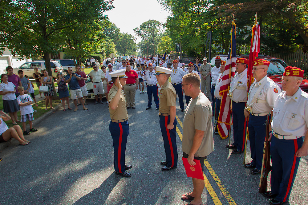 Pitman resident's Patti and Edward Ritter pin captain's bars on their son Teddy Ritter's promotion to Captain in the Marine Corp in front on the Ritter family home in Pitman, NJ on Wednesday July 4, 2012. Photo - Mat Boyle / Gloucester County Times