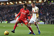 Swindon Town forward Keshi Anderson (10) holds up the ball under pressure from Milton Keynes Dons midfielder (on loan from QPR) David Wheeler (21) during the EFL Sky Bet League 2 match between Milton Keynes Dons and Swindon Town at stadium:mk, Milton Keynes, England on 9 February 2019.
