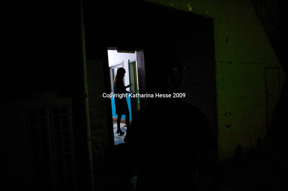 LHASA, JUNE-16, 2009 : a young woman walks into an  elevator in the redlight district that's mostly visited by Chinese.