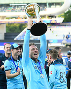 Jos Buttler of England celebrating with the Cricket World Cup trophy on the lap of honour during the ICC Cricket World Cup 2019 Final match between New Zealand and England at Lord's Cricket Ground, St John's Wood, United Kingdom on 14 July 2019.