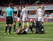 August 5th 2017, Dens Park, Dundee, Scotland; Scottish Premiership; Dundee versus Ross County; Dundee's Sofien Moussa is inspected by physio Gerry Docherty after going down with an injury