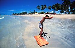 Coroa Grande, Pernambuco, Brasil. 03/1997..Garoto brincando com tabua na praia./ Boy playing with board on the beach..Foto © Marcos Issa/Argosfoto