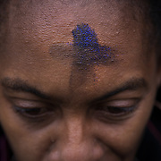 "ALEXANDRIA, VA - MAR1:Tonya Matthews, receives ""glitter ashes"", for Ash Wednesday, outside the Braddock Road metro station, in Alexandria, VA, March 1, 2017. Across the country, churches involved with the advocacy group Parity will be giving out ""glitter ashes"" to demonstrate that LGBT people should be included in Christianity.(Photo by Evelyn Hockstein/For The Washington Post)"