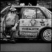 Ernie, a local resident of the Valentine neighborhood in Kansas City, Mo., who piles his Honda Accord with personal belongings, bumper stickers and doll heads.