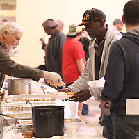 Kirby Young, center right, gets some more turkey Thursday at the annual Salvation Army Thanksgiving Dinner.