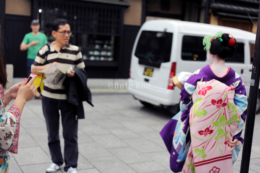 traditionally dressed up maiko walking Kyoto Japan