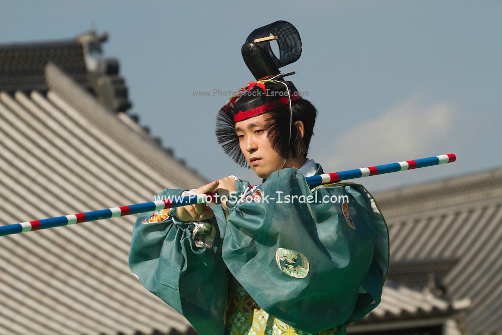 Japan, Kyoto, Imperial Palace, Man wearing traditional Japanese clothing Jidai Matsuri (Festival of Ages)