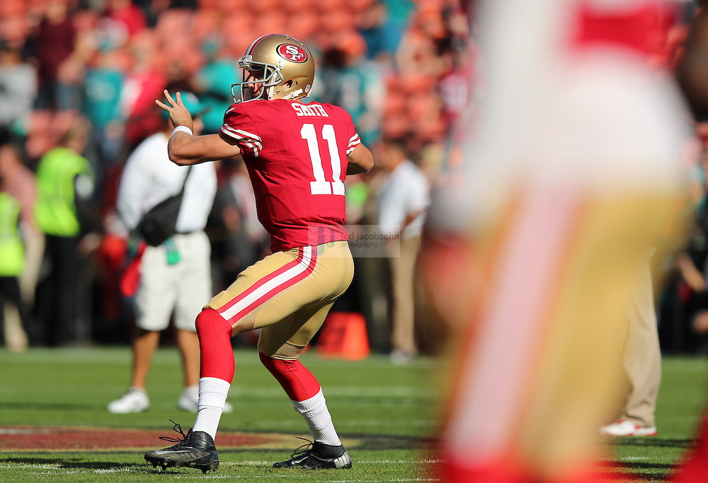 San Francisco 49ers quarterback Colin Kaepernick and San Francisco 49ers quarterback Alex Smith (11) warm up against the Miami Dolphins during an NFL game at Candlestick Park on December 9, 2012 in San Francisco, CA.  (Photo by Jed Jacobsohn)