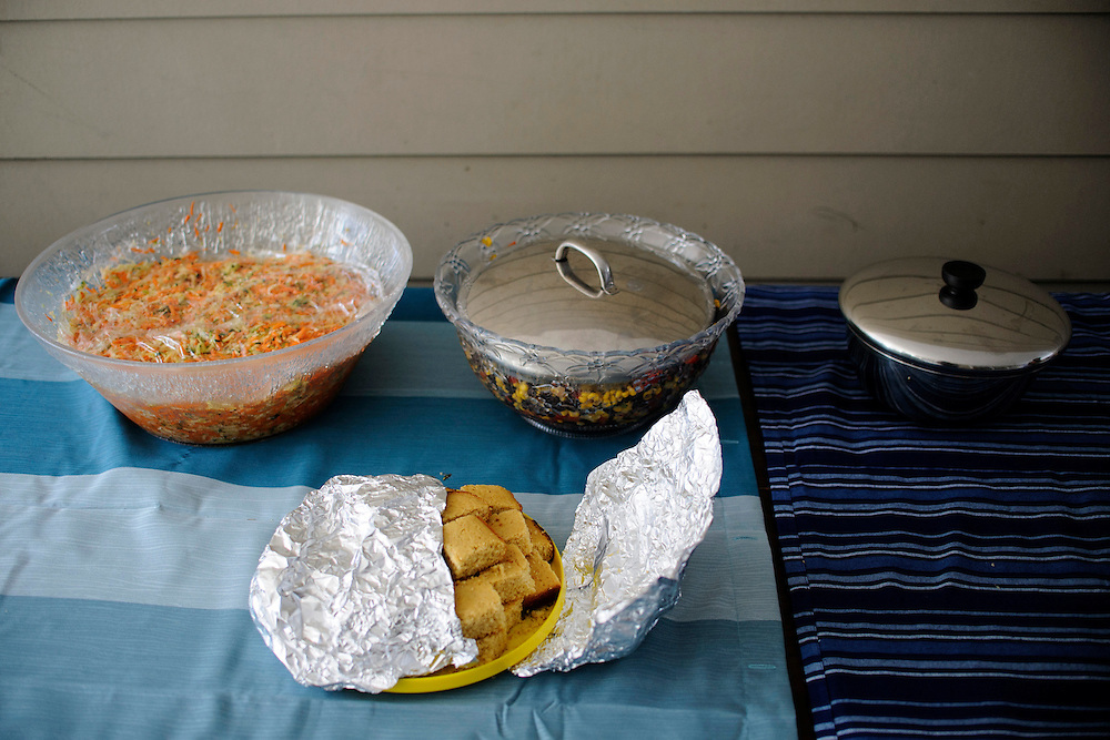 photo by Matt Roth..Norton Francis, says one of the perks about living in cohousing is being able to use the big serving bowls stored at the Common House, rather than needing to buy them and store them at their condo. In preparation for the Green Chile party, Norton and his wife also utilized one of their neighbor's refrigerators and freezers to store food while she was away on business. ..Takoma Village Cohousing in Washington, D.C., Saturday, September 22, 2012