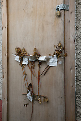 © Licensed to London News Pictures. 23/09/2013. Derby, UK. Pictured, the door holding faded flowers to Number 18, Victory Street, Derby, the house wher six children died in a house fire set by by their parents was starting to be demolished today. Photo credit : Dave Warren/LNP