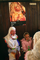 At the Sunday lunch party - more than 300 guests ate in shifts in just one of two cafes big enough to host a party - the guests ate bellow pictures of half naked Bulgarian singers - in stark contrast to their own outfits. A bit of Bulgarian culture making its in way.