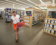Judy Elliott, of Rock Island, walks by the Health Market section at a Hy-Vee store in Rock Island, Illinois on Tuesday August 7, 2012.