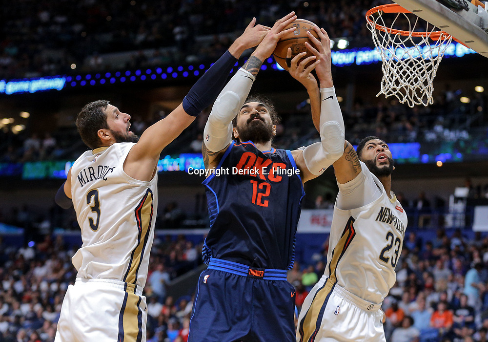 Apr 1, 2018; New Orleans, LA, USA; Oklahoma City Thunder center Steven Adams (12) battles for a rebound with New Orleans Pelicans forward Anthony Davis (23) and forward Nikola Mirotic (3) during the second quarter at the Smoothie King Center. Mandatory Credit: Derick E. Hingle-USA TODAY Sports