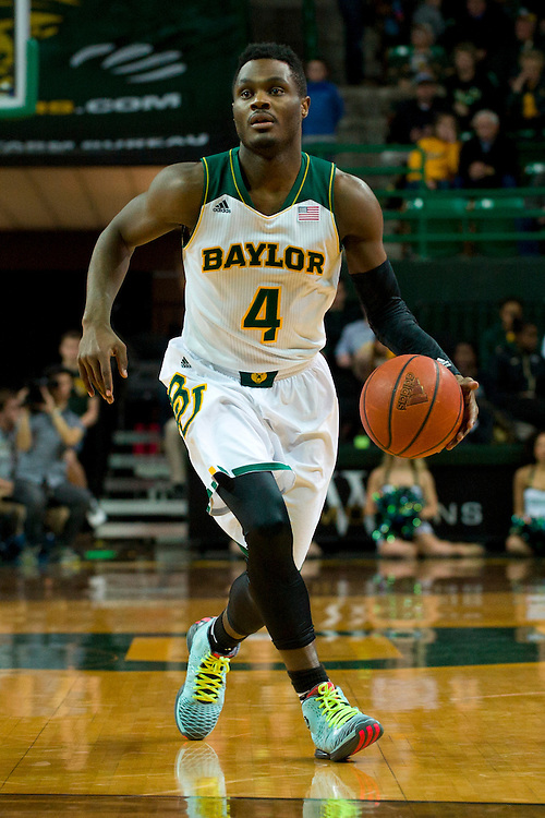 WACO, TX - JANUARY 28: Gary Franklin #4 of the Baylor Bears brings the ball up court against the West Virginia Mountaineers on January 28, 2014 at the Ferrell Center in Waco, Texas.  (Photo by Cooper Neill/Getty Images) *** Local Caption *** Gary Franklin