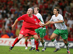 CARDIFF, WALES - Wednesday, September 8, 2004: Wales' John Hartson in action against Northern Ireland's Mark Williams during the Group Six World Cup Qualifier at the Millennium Stadium. (Pic by David Rawcliffe/Propaganda)