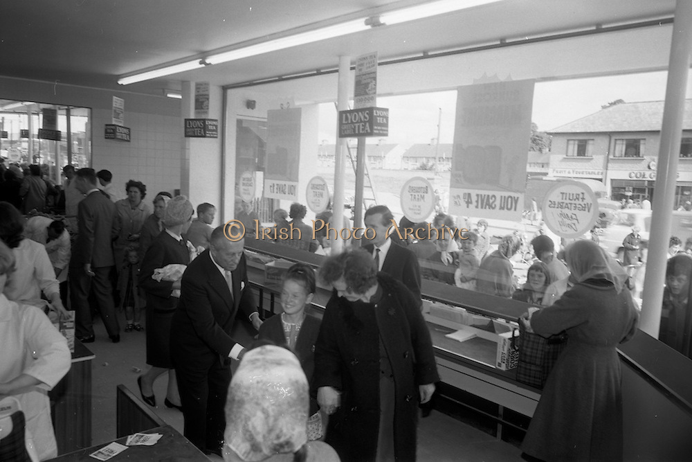 08/07/1965 <br /> 07/08/1965<br /> 08 July 1965<br /> Opening of Powers Supermarket in Ballyfermot.  Mr. Garfield Weston (centre) chatting  with customers on opening day.