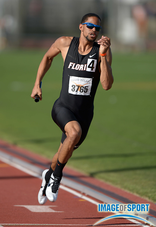Mar 29, 2014; Austin, TX, USA; Arman Hall runs the anchor leg on the Florida 4 x 400m relay that won in 3:01.26 in the 87th Clyde Littlefield Texas Relays at Mike A. Myers Stadium.