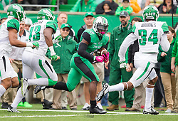 Oct 24, 2015; Huntington, WV, USA; Marshall Thundering Herd running back Remi Watson looks for extra space against the North Texas Mean Green during the first quarter at Joan C. Edwards Stadium. Mandatory Credit: Ben Queen-USA TODAY Sports