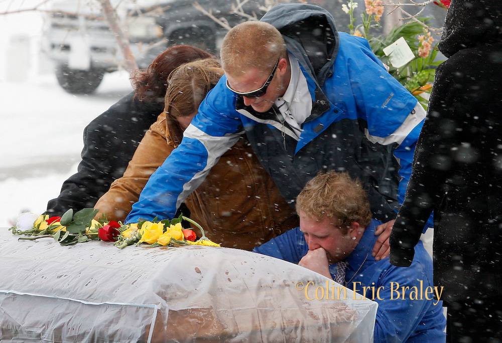 Friends of  Pfc. Aaron Nemelka say goodbye after a burial ceremony at Camp Williams, Saturday Nov. 14, 2009 in Riverton, Utah. Nemelka was one of 13 gunned down at Fort Hood, Texas. (AP Photo/Colin E Braley)