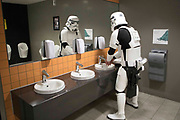 UNITED KINGDOM, London: 27 May 2018 A cosplay fan dressed as a Storm Trooper washes his hands at the MCM London Comic Con. The three day comic convention, which is held at London's ExCeL, was visited by thousands of avid cosplay fans and enthusiasts. Rick Findler / Story Picture Agency