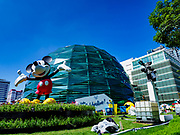 30 OCTOBER 2018 - BANGKOK, THAILAND: A statue of Mickey Mouse in front of the King Power shopping complex in Bangkok. Vichai Srivaddhanaprabha, owner of King Power, the Thai duty free airport shops, and Leicester City soccer club, died Saturday, 27 October, in a helicopter crash after a soccer match in the UK.  Vichai's death was announced on the same day that King Power announced a promotional program with Disney. PHOTO BY JACK KURTZ