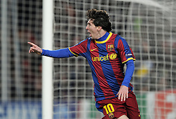 Lionel Messi of Barcelona celebrates after scoring his sides opening goal during the UEFA Champions League round of 16 second leg match between Barcelona and Arsenal on March 8, 2011 in Barcelona, Spain.