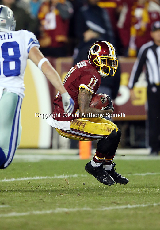 Washington Redskins wide receiver DeSean Jackson (11) returns a fourth quarter punt that he fumbles and turns over to the Dallas Cowboys during the 2015 week 13 regular season NFL football game against the Dallas Cowboys on Monday, Dec. 7, 2015 in Landover, Md. The Cowboys won the game 19-16. (©Paul Anthony Spinelli)